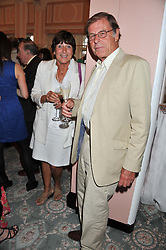 TREVOR GROVE and VALERIE GROVE at the 20th anniversary reception for The Oldie Magazine held at Simpsons in The Strand, London on 19th July 2012.