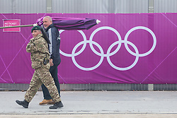 © licensed to London News Pictures. London, UK 14/07/2012. A soldier and a Olympic staff walking outside the Olympic site in Stratford today. Photo credit: Tolga Akmen/LNP