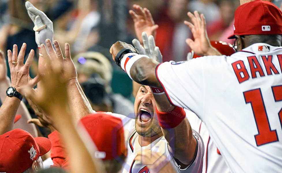 WASHINGTON, DC - OCTOBER 07:  Washington Nationals first baseman Ryan Zimmerman (11) reacts in the dugout after hitting a game wining 3-run home run in the eighth inning during game two of the NLDS between the Chicago Cubs and the Washington Nationals on October 7, 2017, at Nationals Park, in Washington D.C.  The Washington Nationals defeated the Chicago Cubs, 6-3.  (Photo by Mark Goldman/Icon Sportswire)