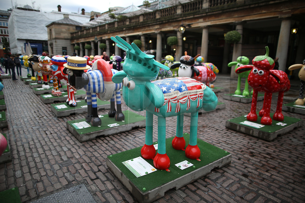© Licensed to London News Pictures. 24/09/2015. London, UK. 120 Shaun the Sheep sculptures are placed in Covent Garden market ahead of their auction. The auction, on the 8th October 2015, will raise funds for the Wallace & Gromit's Children's Charity supporting children's hospitals and hospices throughout the UK.  Photo credit: Peter Macdiarmid/LNP