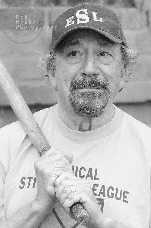 """Stefan """"The Wise One"""" Kanfer, an author from Hastings-on-Hudson, prepares to bat during a game of stickball..---.The Ethical Stickball League has been operating since 1970, meeting every Sunday in the parking lot behind Hastings High School from 10:30AM to 1PM.  The players are men now mostly in their 70s - carrying nicknames like """"The Wise One"""", """"Hit Man"""" and """"Plays Hurt"""" - who have an affiliation with the school, either as former teachers, students or neighbors. As their slogan suggests, all it takes for a few hours of """"Aestas Aeterna"""" (Eternal Summer) is an outside temperature above 45 degrees and 8 willing souls...CREDIT: Rob Bennett for The NY Times"""