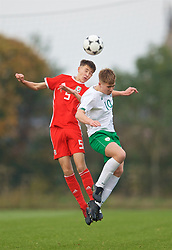 WREXHAM, WALES - Wednesday, October 30, 2019: Wales' Ben Hammond (L) head and Republic of Ireland's Tom Lonergan during the 2019 Victory Shield match between Wales and Republic of Ireland at Colliers Park. (Pic by David Rawcliffe/Propaganda)