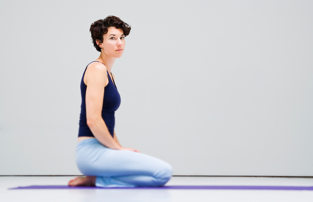Portrait of young woman in a yoga studio.