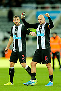 Jonjo Shelvey (#8) of Newcastle United celebrates with Paul Dummett (#3) of Newcastle United following the Premier League match between Newcastle United and Southampton at St. James's Park, Newcastle, England on 8 December 2019.