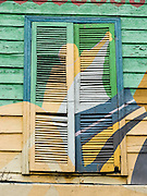 "Louvered window shutters are painted yellow and green in San Telmo barrio, the heart of old Buenos Aires, Argentina, South America. Admire well-preserved buildings in San Telmo (""Saint Pedro González Telmo""), the oldest barrio (neighborhood) of Buenos Aires, in Argentina, South America."