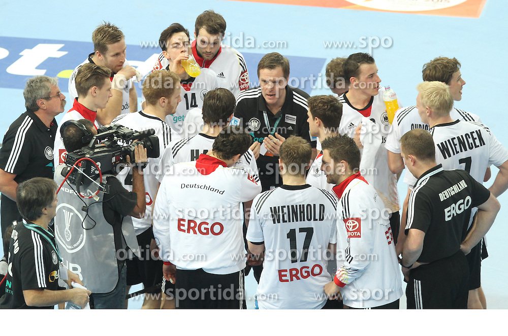 18.01.2013 Barcelona, Spain. IHF men's world championship, prelimanary round. Picture show german team at time out during game between France vs Germany at Palau St Jordi / Sportida Photo Agency