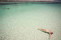 The dazzlingly clear waters of Kenya coastline on Diani Beach.