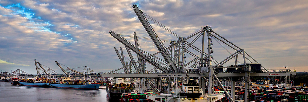 The Port of Savannah ship to shore cranes lower their booms to start work on several container ships after the Savannah River reopened following Hurricane Matthew in Garden City, Ga., Wednesday, Oct.12, 2016. Nine vessels worked at the Garden City Terminal on Wednesday. (AP Photo/Georgia Port Authority, Stephen Morton)