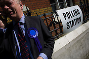 A conservative Teller makeds a call outside St Peter's Primary School, Ebury Street, Belgravia that serves as a temporary Polling station for voters on Britain's general election day. The job of the teller is to record the election numbers of those about to vote, making sure that their political colleagues don't drop more literature in to that address, now that the occupants have voted.