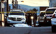 A body lies on Reno Ct. in Wilkes-Barre at dusk after a shooting Thursday evening, a fight between two children ended with one fater in prison and another deceased.