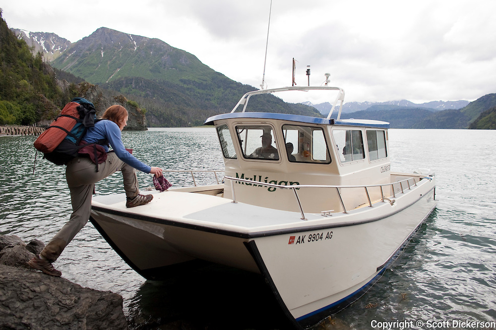 A Mako's Water Taxi boat picks up Stephanie Haynes after hiking on the Saddle and Alpine Ridge trail in Kachemak Bay State Park, near Homer, Alaska.