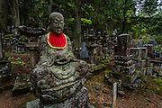 In the middle of Okunoin cemetery it is common to see statues of Jizo and Buddhas