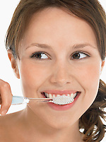 Young Woman Brushing Teeth close up head shot
