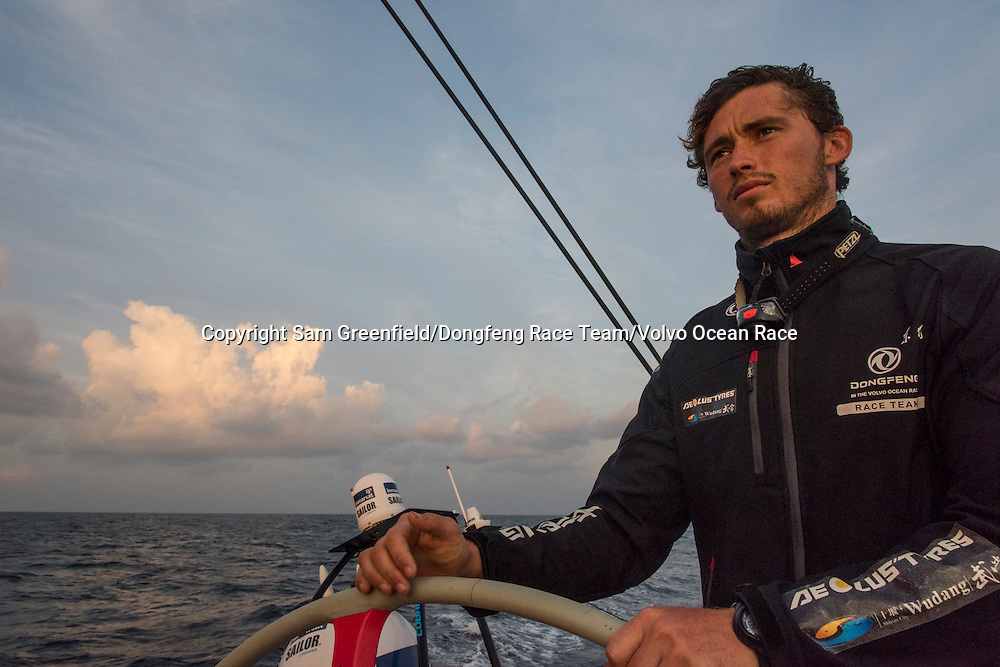 January, 2015. Leg 3 to Sanya onboard Dongfeng Race Team. Day 16. Jack Bouttell helping the boat, leaving the clouds behind.