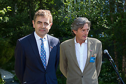 "© Licensed to London News Pictures. 19/05/2014. London, England. Pictured: Actors Rowan Atkinson and Nigel Havers reading war poems.  Show Garden ""No Man's Land: ABF The Soldiers' Charity Garden to mark the centenary of World War One.  Press Day at the RHS Chelsea Flower Show. On Tuesday, 20 May 2014 the flower show will open its doors to the public.  Photo credit: Bettina Strenske/LNP"