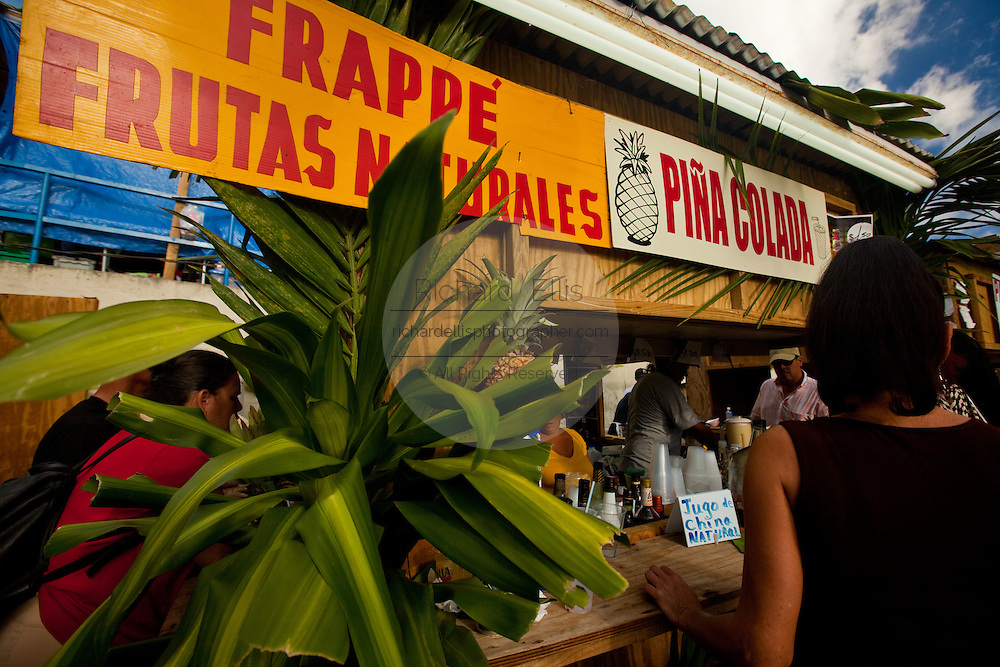 Vendor selling tropical drinks during the Maricao Coffee Festivals in the highlands of Puerto Rico