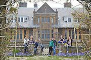 The Elliott and Baker families in the garden at Pickwell Manor. From left to right: Tracey Elliott, Millie-grace Elliott (8), Richard Eliott, Molly Elliott (10), Zac Baker (11), Steve Baker, Liza Baker (9), Susannah Baker. Pickwell Manor, Georgeham, North Devon, UK.<br /> CREDIT: Vanessa Berberian for The Wall Street Journal<br /> HOUSESHARE