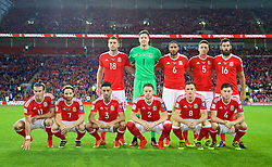 CARDIFF, WALES - Monday, September 5, 2016: Wales' players line up for a team group photograph before the 2018 FIFA World Cup Qualifying Group D match against Moldova at the Cardiff City Stadium. Back row L-R:  Sam Vokes, goalkeeper Wayne Hennessey, captain Ashley Williams, James Chester, Joe Ledley. Front row L-R: Gareth Bale, Joe Allen, Neil Taylor, Chris Gunter, Andy King, Ben Davies.(Pic by David Rawcliffe/Propaganda)
