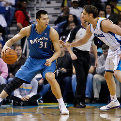 February 1, 2011; New Orleans, LA, USA; Washington Wizards power forward Yi Jianlian (31) is guarded by New Orleans Hornets center David Andersen (11) during the second quarter at the New Orleans Arena.   Mandatory Credit: Derick E. Hingle