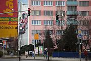 Riesige Werbung an einem Plattenbau fuer den neuen Skoda Superb in der Naehe der Skoda Autowerke im Zentrum von Mlada Boleslav. Mlada Boleslav liegt noerdlich von Prag und ist ungefaehr 60 Kilometer von der tschechischen Haupstadt entfernt. Skoda Auto besch&auml;ftigt in Tschechien 23.976 Mitarbeiter (Stand 2006), den Grossteil davon in der Zentrale in Mlada Boleslav. Damit sind mehr als 3/4 aller Erwerbst&auml;tigen der Stadt in dem Automobilkonzern t&auml;tig.<br /> <br />                                       Bigboard commercial at a panel house close to the Skoda factory in the city of Mlada Boleslav. The city is located north of Prague and about 60 km away from the Czech capital. Skoda Auto has about 23.976 employees (2006) in Czech Republic and a big part of them is working in Mlada Boleslav. 3/4 of the working population in Mlada Boleslav is working for the Skoda Auto company.