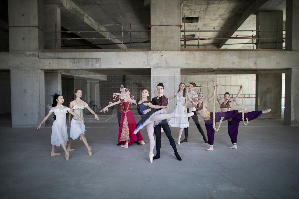 © Licensed to London News Pictures. 21/03/2017. London, UK. Performers strike a pose in The Central School of Ballet's newly announced building in central London. The dancers wear costumes from their forthcoming nationwide Ballet Central tour 2017 against the backdrop of the unfinished interior of the new premises. Photo credit: Peter Macdiarmid/LNP