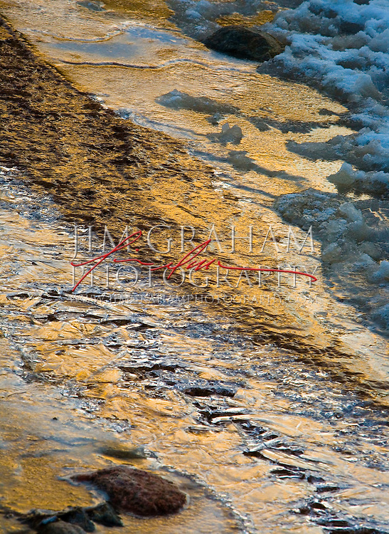 Early light reflects from an ice covered arroyo in Santa Fe, New Mexico.(Photography by Jim Graham)