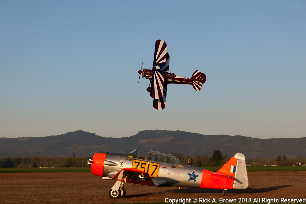 "N3N-3 ""Old Glory"" in flight with a team from the Vintage Air Rally."