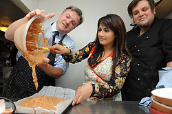 © Licensed to London News Pictures. 27/10/2014<br /> Naushabah Khan and Ed Balls making Carrot Cake .<br /> Ed Balls, Labour's shadow chancellor,has been in Rochester on the campaign trail  today(27.10.2014)<br /> Mr Balls was joined by Labour candidate Naushabah Khan at Bruno's French Bakes shop in Rochester high Street to meet local people and make Carrot cake with Bruno Breillet  (Pastry Chief) and Naushabah Khan .<br /> Hilary Benn MP, Labour's Shadow Communities and Local Government Secretary was also at the event.<br /> <br /> (Byline:Grant Falvey/LNP)
