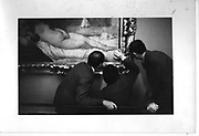 Gallery Attendants examining a Titian in the Uffizi Gallery Florence. 1977      ONE TIME USE ONLY - DO NOT ARCHIVE  © Copyright Photograph by Dafydd Jones 66 Stockwell Park Rd. London SW9 0DA Tel 020 7733 0108 www.dafjones.com