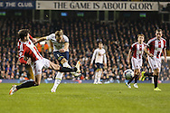 Harry Kane of Tottenham Hotspur (2nd left) shoots during the Capital One Cup Semi-Final 1st Leg match between Tottenham Hotspur and Sheffield Utd at White Hart Lane, London, England on 21 January 2015. Photo by David Horn.