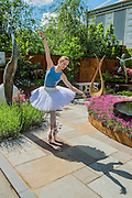 Ksenia Ovsyanick of the English National Ballet on the Simon Gudgeon Stand - The opening day of th Chelsea Flower Show.