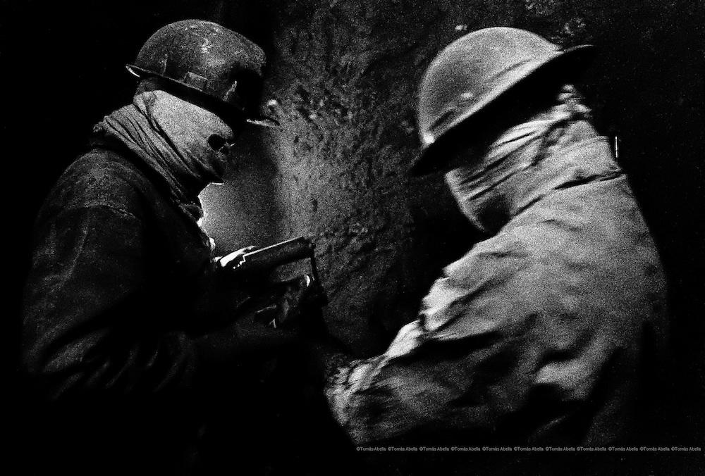Miners preparing the jackhammer in Cerro Rico of Potosí. Bolivia.