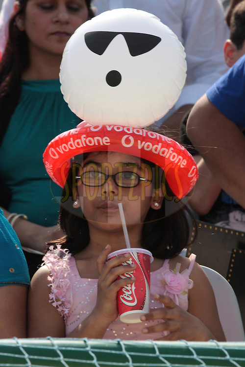 A girl drinks during match 9 of the Indian Premier League ( IPL ) Season 4 between the Kings XI Punjab and the Chennai Super Kings held at the PCA stadium in Mohali, Chandigarh, India on the 13th April 2011..Photo by Anil Dayal/BCCI/SPORTZPICS