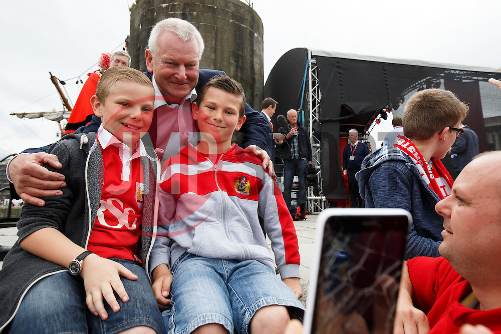 Majority Shareholder Steve Lansdown poses for selfies as thousands of fans fill Lloyds Amphitheatre during the Bristol City open top bus parade to celebrate winning both the League 1 and Johnstone's Paint Trophy titles this season and promotion to the Championship - Photo mandatory by-line: Rogan Thomson/JMP - 07966 386802 - 04/05/2015 - SPORT - FOOTBALL - Bristol, England - Bristol City Bus Parade.