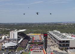 October 21, 2018 - Austin, USA - A group of helicopters from the 302nd Aviation Squadron based at Fort Hood, Texas, flies over the starting grid just before the Formula 1 U.S. Grand Prix at the Circuit of the Americas in Austin, Texas on Sunday, Oct. 21, 2018. (Credit Image: © Scott Coleman/ZUMA Wire)