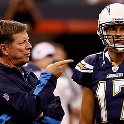 August 27, 2010; New Orleans, LA, USA; San Diego Chargers head coach Norv Turner and quarterback Philip Rivers (17) talk on the field prior to kickoff of a preseason game against the New Orleans Saints at the Louisiana Superdome. Mandatory Credit: Derick E. Hingle