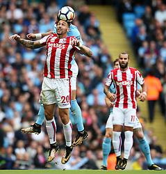 Geoff Cameron of Stoke City wins a header - Mandatory by-line: Matt McNulty/JMP - 14/10/2017 - FOOTBALL - Etihad Stadium - Manchester, England - Manchester City v Stoke City - Premier League