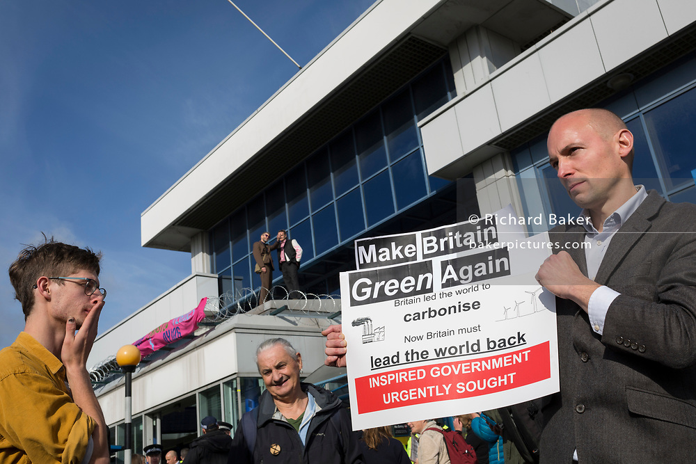 Environmental activists protest about Climate Change during the occupation of City Airport (London's Business Travel hub) in east London, the fourth day of a two-week prolonged worldwide protest by members of Extinction Rebellion, on 10th October 2019, in London, England.