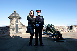 Miss Scotland Jennifer Reochs at the One O'clock gun with Gunner Jamie Shannon..The Miss World participants visit Edinburgh Castle and will witness the firing of the One O'clock gun..MISS WORLD 2011 VISITS SCOTLAND..Pic © Michael Schofield.