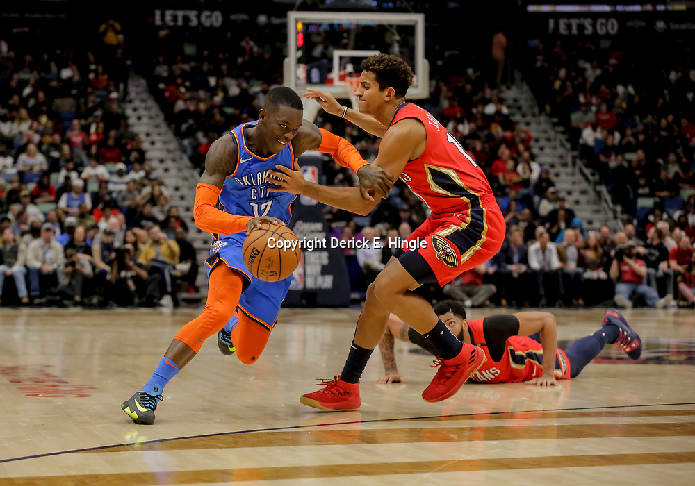 Dec 12, 2018; New Orleans, LA, USA; Oklahoma City Thunder guard Dennis Schroder (17) drives past New Orleans Pelicans guard Frank Jackson (15) during the second quarter at the Smoothie King Center. Mandatory Credit: Derick E. Hingle-USA TODAY Sports