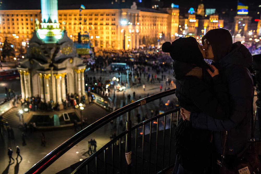 KIEV, UKRAINE - DECEMBER 3: Julia Rudchenko, 21, and Vadik Kanashuk, 19 (R), kiss during anti-government protests in Independence Square on December 3, 2013 in Kiev, Ukraine. Thousands of people have been protesting against the government since a decision by Ukrainian president Viktor Yanukovych to suspend a trade and partnership agreement with the European Union in favor of incentives from Russia. (Photo by Brendan Hoffman/Getty Images) *** Local Caption *** Julia Rudchenko;Vadik Kanashuk