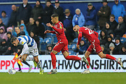 Queens Park Rangers defender Dominic Ball (12) survives one challenge during the EFL Sky Bet Championship match between Queens Park Rangers and Middlesbrough at the Kiyan Prince Foundation Stadium, London, England on 9 November 2019.