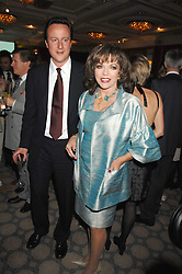 DAVID CAMERON MP and JOAN COLLINS at a party to celebrate the 180th Anniversary of The Spectator magazine, held at the Hyatt Regency London - The Churchill, 30 Portman Square, London on 7th May 2008.<br /><br />NON EXCLUSIVE - WORLD RIGHTS