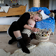 Friland, Feldballe, Denmark, June 8, 2010. A young mother and his baby living in the ecological community of Friland.<br />