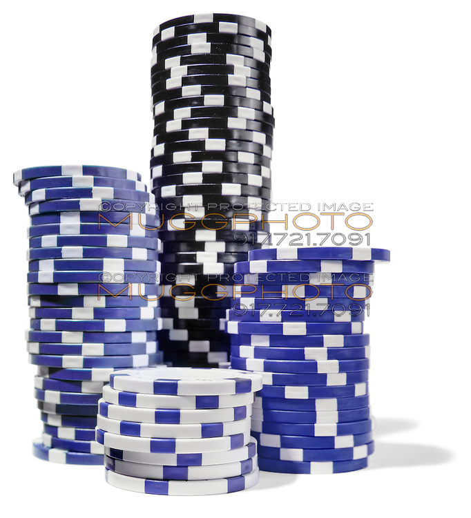 black white and blue stacks of poker chips