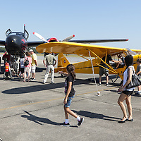 People look at planes during Aviation Day Saturday October 11, 2014 at Wilmington International Airport in Wilmington, N.C. (Jason A. Frizzelle)