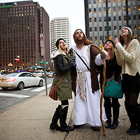 "Leah DeTommaso, 19, Alisyn Davidson, 19, and Taylor Moran, 18, ask to take a photograph with (center) Michael Grant, 28, ""Philly Jesus,"" on December 14, 2014.  Nearly everyday for the last 8 months, Grant has dressed as Jesus Christ, and walked the streets of Philadelphia to share the Christian gospel by example.  He quickly acquired the nickname of ""Philly Jesus,"" which he has gone by ever since. REUTERS/Mark Makela (UNITED STATES)"