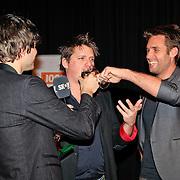 NLD/Hilversum/20130109 - Uitreiking 100% NL Awards 2012, Nick Schilder en Simon Keizer laten Kees Tol champagne drinken