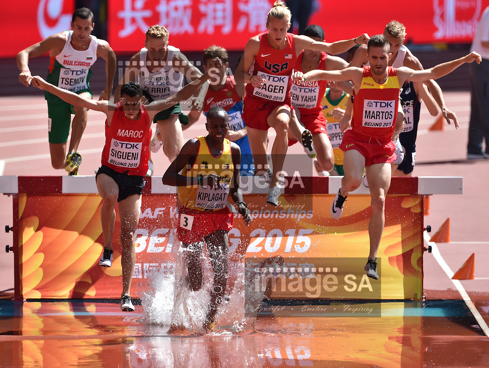 BEIJING, CHINA - AUGUST 22: Benjamin Kiplagat (Uganda), Amor Ben Yahia (Tunisia), Evan Jager (USA), Hicham Sigueni (Morocco) and Sebastian Martos (Spain) in Round 1 of the mens 3000m steeplechase during day 1 of the 2015 IAAF World Championships at National Stadium on August 22, 2015 in Beijing, China. (Photo by Roger Sedres/Gallo Images)