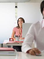 Businesswoman at desk half length